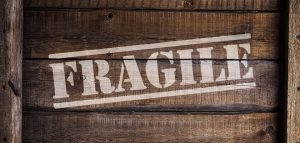 a sign fragile on the wooden box