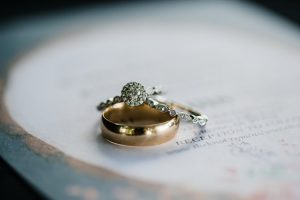 An engagement and wedding ring on a document.