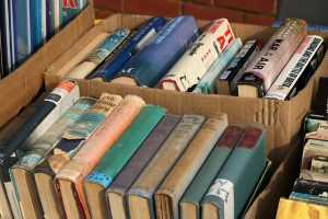 Books in the cardboard boxes - wrong way to store your book collection.