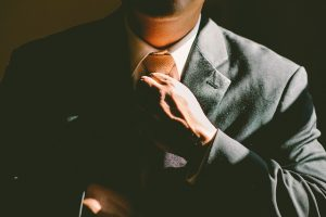 a man in a suit - Boost your relocation budget with professionals