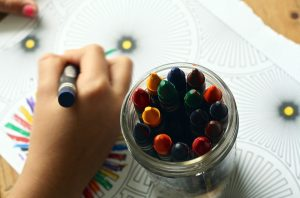 include your kids in the unpacking process by giving them crayons to draw on empty boxes