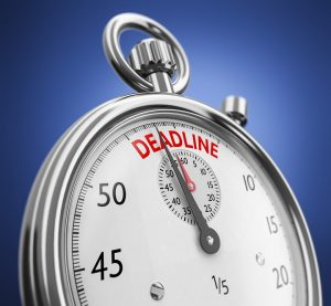 a stopwatch with deadline written in it in red letters
