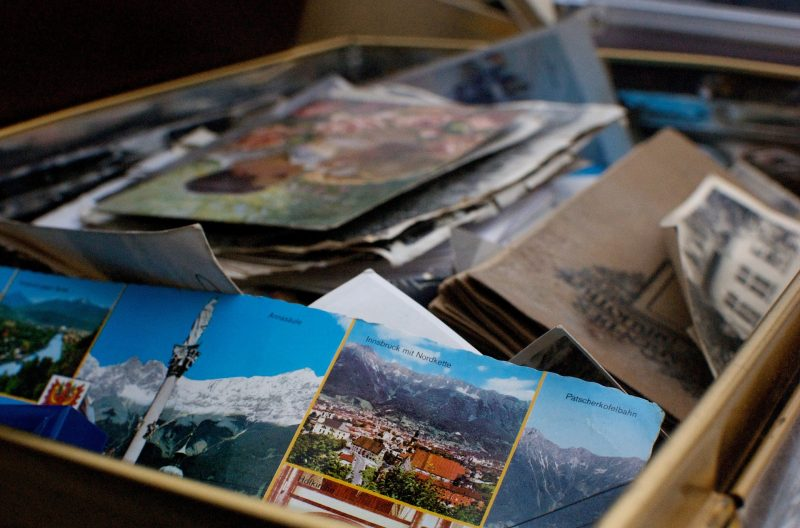 box of postcards - Professionals can help you pack when moving an elderly parent.