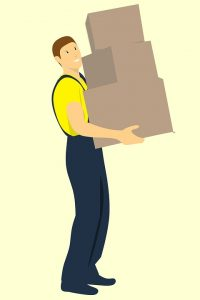 a man moving boxes - put finding a reliable moving company in your pre-move checklist